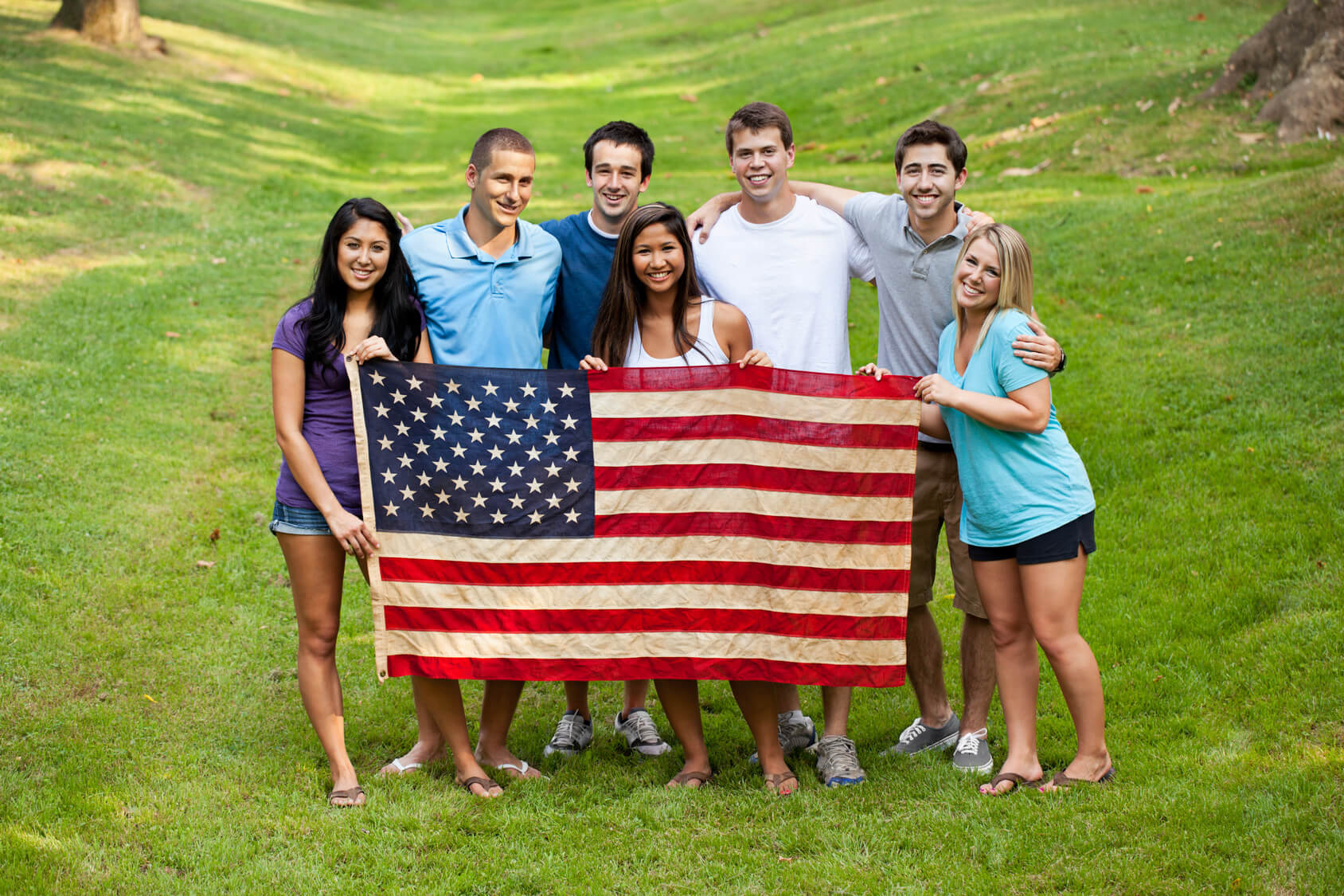 youth in summer jobs programs gain several skills move to america group of diverse college students holding american flag
