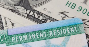 USA Permanent Resident card aka Green Card and paper money