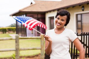 black woman with USA flag outdoors